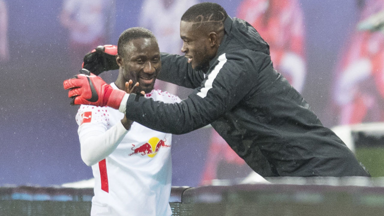 Leipzig's Guinean midfielder Naby Keita (L) celebrates scoring with Leipzig's Swiss goalkeeper Yvon Mvogo during the German first division Bundesliga football match between RB Leipzig and Werder Bremen in Leipzig, eastern Germany on November 25, 2017. during the German First division Bundesliga football match between RB Leipzig and Werder Bremen in Leipzig, eastern Germany, on November 25, 2017. / AFP PHOTO / ROBERT MICHAEL / RESTRICTIONS: DURING MATCH TIME: DFL RULES TO LIMIT THE ONLINE USAGE TO 15 PICTURES PER MATCH AND FORBID IMAGE SEQUENCES TO SIMULATE VIDEO. == RESTRICTED TO EDITORIAL USE == FOR FURTHER QUERIES PLEASE CONTACT DFL DIRECTLY AT + 49 69 650050