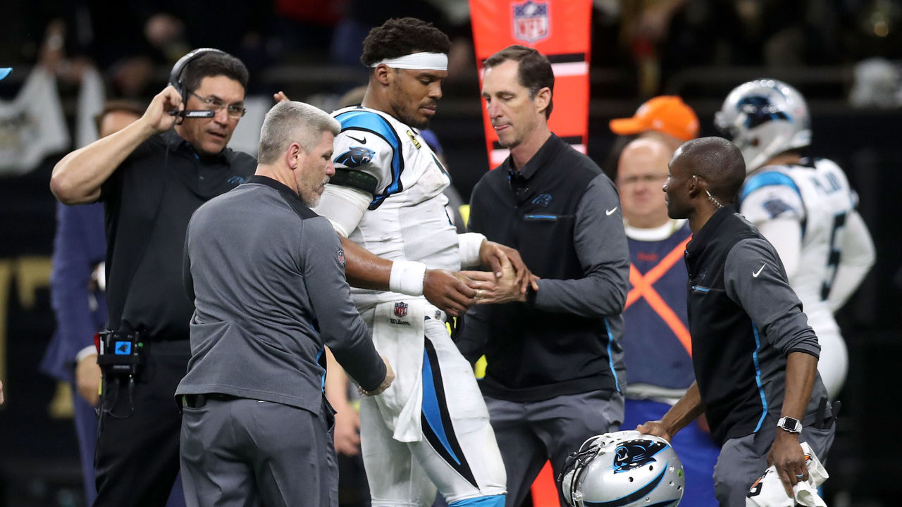 NEW ORLEANS, LA - JANUARY 07: Cam Newton #1 of the Carolina Panthers is checked on the sideline after a tackle during the game against the New Orleans Saints at the Mercedes-Benz Superdome on January 7, 2018 in New Orleans, Louisiana.
