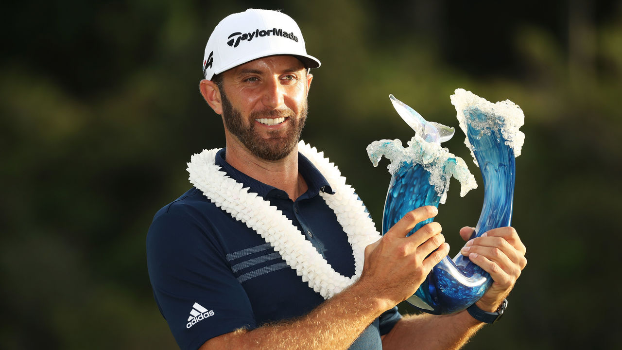 LAHAINA, HI - JANUARY 07: Dustin Johnson of the United States celebrates with the winner's trophy after winning during the final round of the Sentry Tournament of Champions at Plantation Course at Kapalua Golf Club on January 7, 2018 in Lahaina, Hawaii.