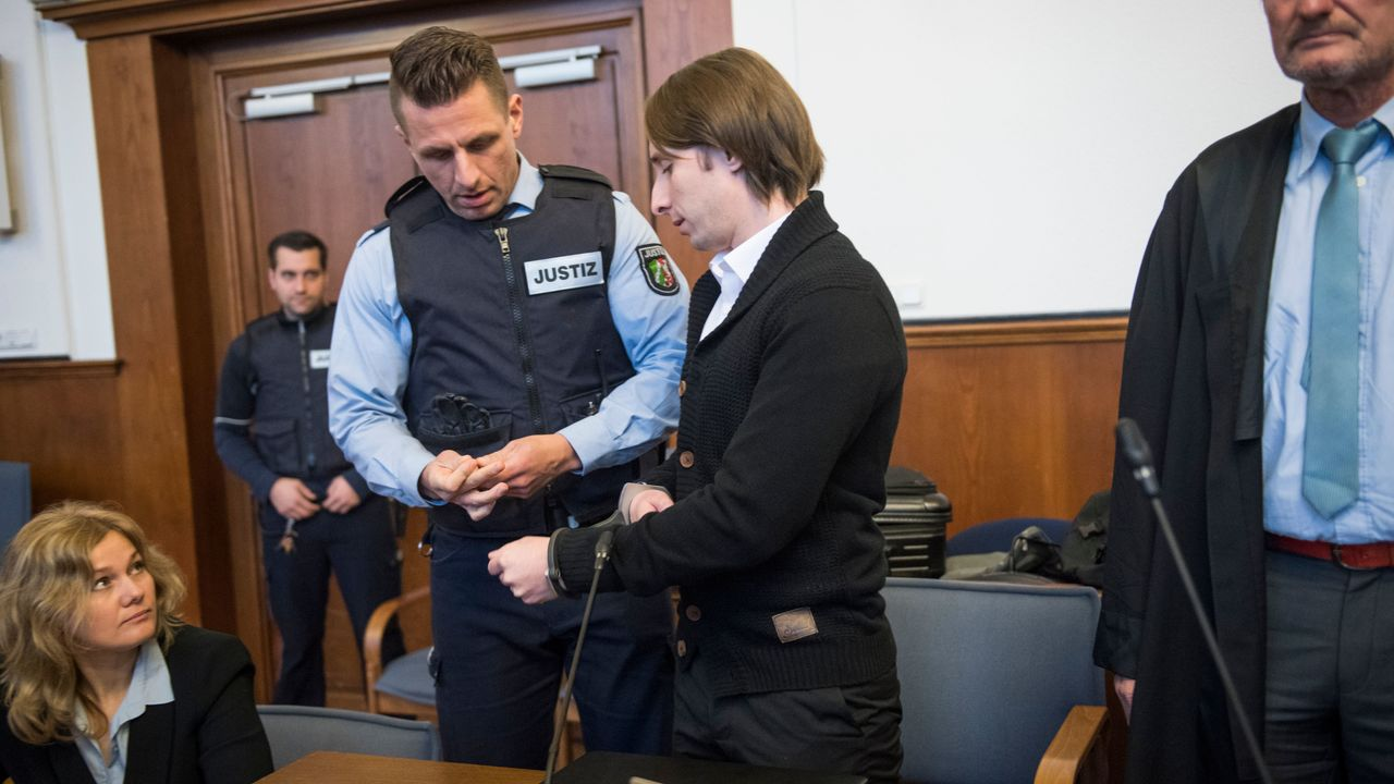 The German-Russian suspect, known as Sergei W, who is accused of having carried out a bomb attack on the Borussia Dortmund football team's bus, arrives for his trial on January 08, 2018 at the district courthouse in Dortmund, western Germany. The suspect was arrested 10 days after he allegedly set off three explosive devices hidden in a hedge as the bus was leaving the team hotel for a Champions League match in an elaborate bid to make a fortune on the stock market. / AFP PHOTO / POOL / Bernd Thissen