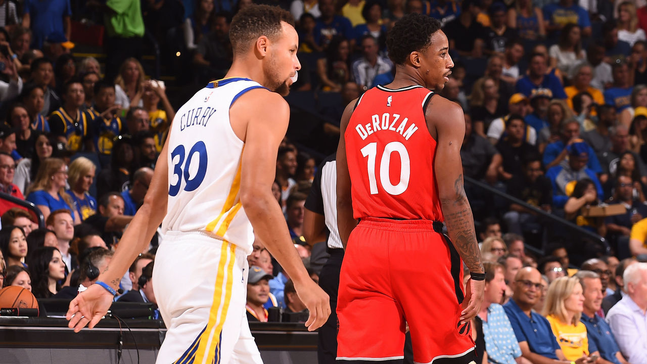 OAKLAND, CA - OCTOBER 25: Stephen Curry #30 of the Golden State Warriors and DeMar DeRozan #10 of the Toronto Raptors walk up court during the game on October 25, 2017 at ORACLE Arena in Oakland, California. NOTE TO USER: User expressly acknowledges and agrees that, by downloading and or using this photograph, user is consenting to the terms and conditions of Getty Images License Agreement. Mandatory Copyright Notice: Copyright 2017 NBAE