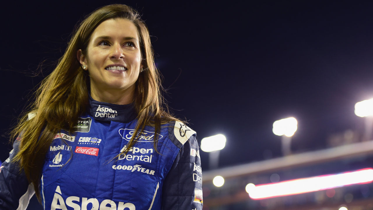 HOMESTEAD, FL - NOVEMBER 17: Danica Patrick, driver of the #10 Aspen Dental Ford, stands on the grid during qualifying for the Monster Energy NASCAR Cup Series Championship Ford EcoBoost 400 at Homestead-Miami Speedway on November 17, 2017 in Homestead, Florida.