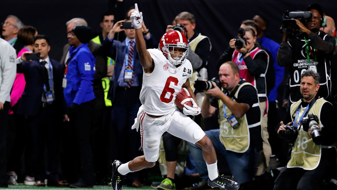 ATLANTA, GA - JANUARY 08: DeVonta Smith #6 of the Alabama Crimson Tide celebrates catching a 41 yard touchdown pass to beat the Georgia Bulldogs in the CFP National Championship presented by AT&T in overtime at Mercedes-Benz Stadium on January 8, 2018 in Atlanta, Georgia.