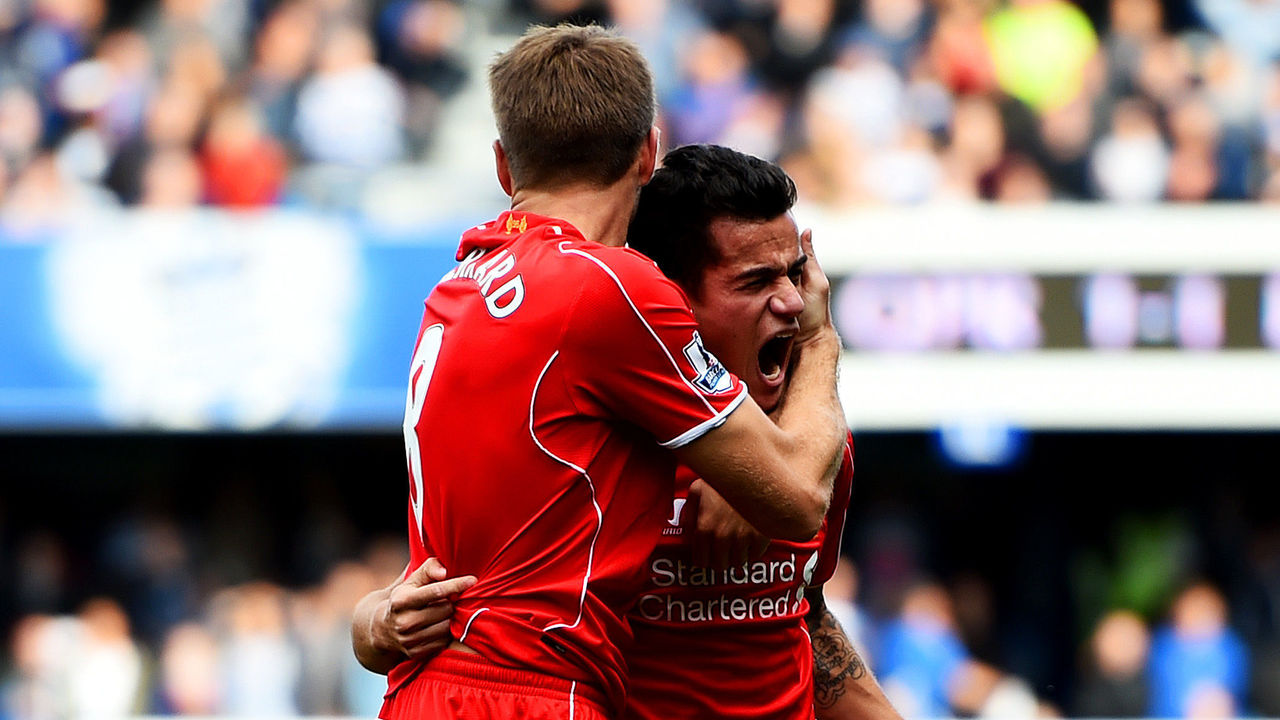 LONDON, ENGLAND - OCTOBER 19: Philippe Coutinho of Liverpool celebrates with team-mate Steven Gerrard after scoring his team's second goal during the Barclays Premier League match between Queens Park Rangers and Liverpool at Loftus Road on October 19, 2014 in London, England.