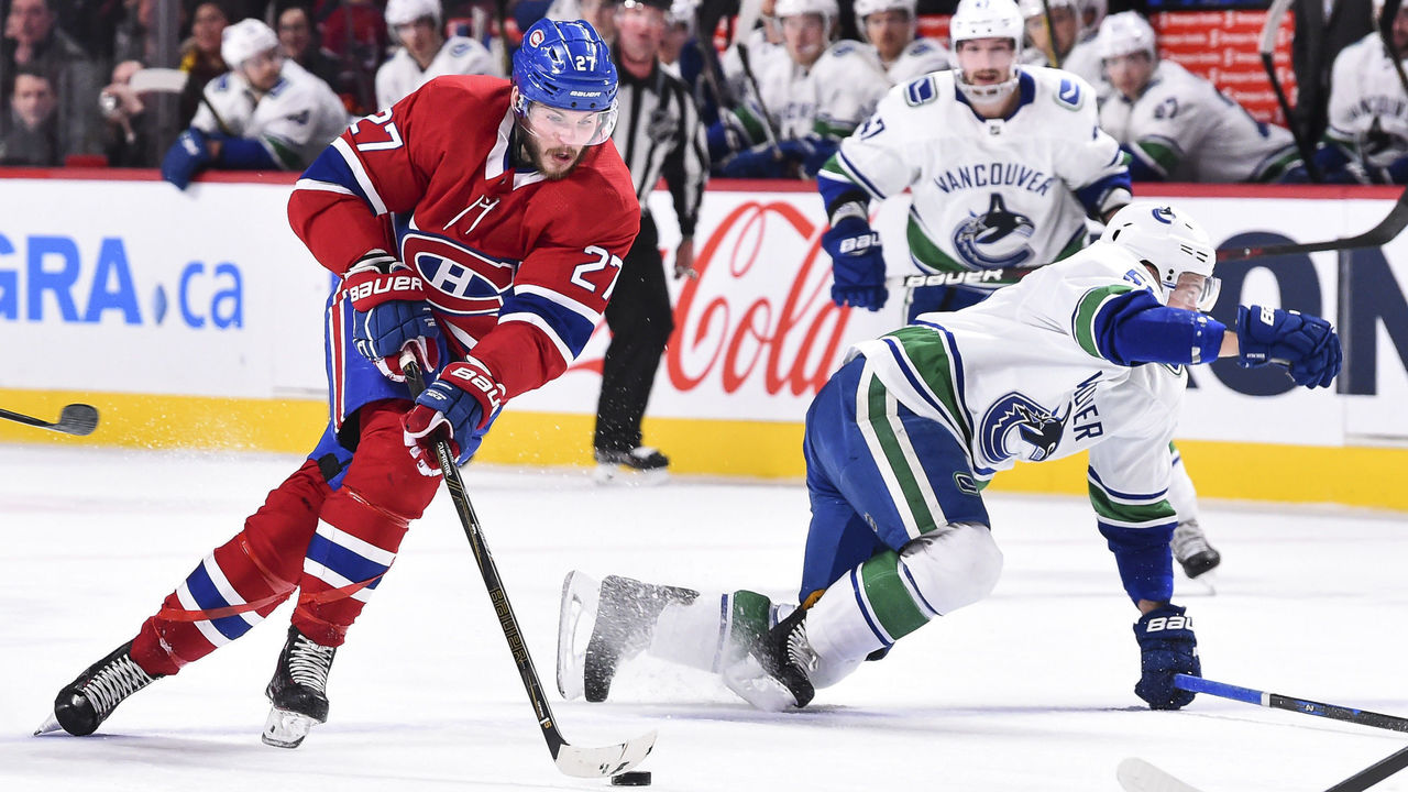 MONTREAL, QC - JANUARY 07: Alex Galchenyuk #27 of the Montreal Canadiens skates the puck against the Vancouver Canucks during the NHL game at the Bell Centre on January 7, 2018 in Montreal, Quebec, Canada.