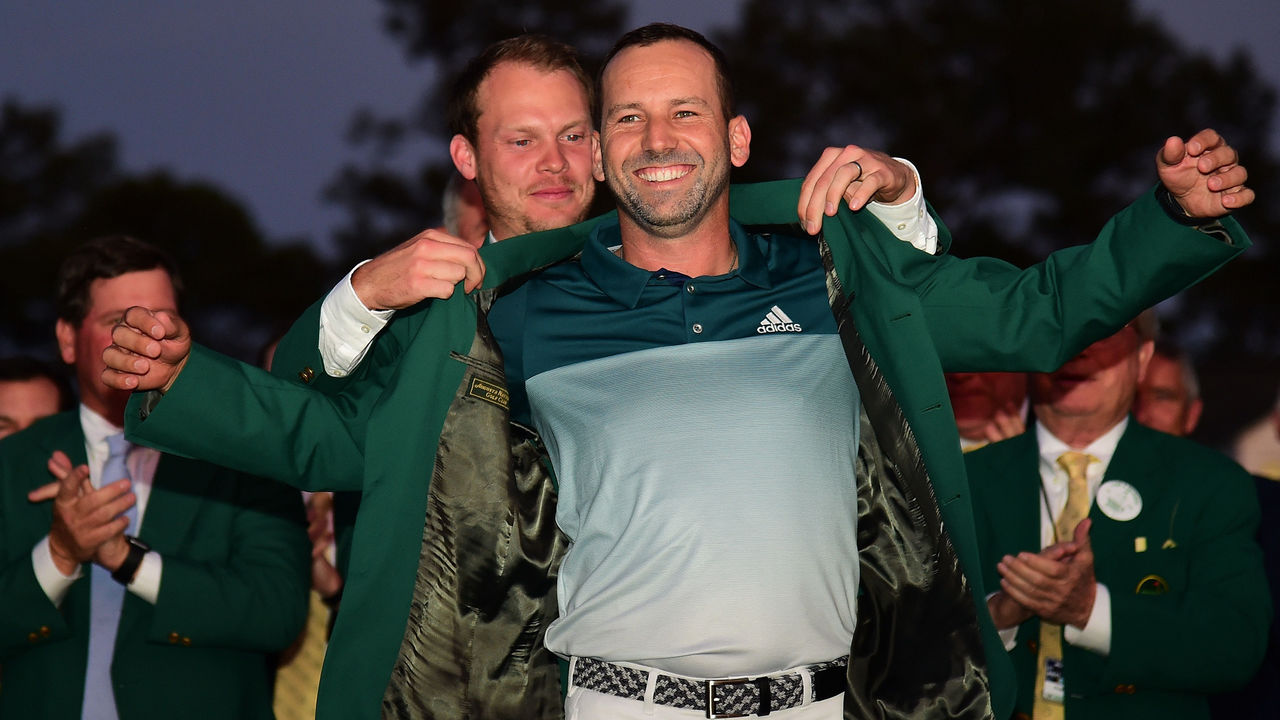 AUGUSTA, GA - APRIL 09: Danny Willett of England presents Sergio Garcia of Spain with the Green Jacket after Garcia won in a playoff during the final round of the 2017 Masters Tournament at Augusta National Golf Club on April 9, 2017 in Augusta, Georgia.