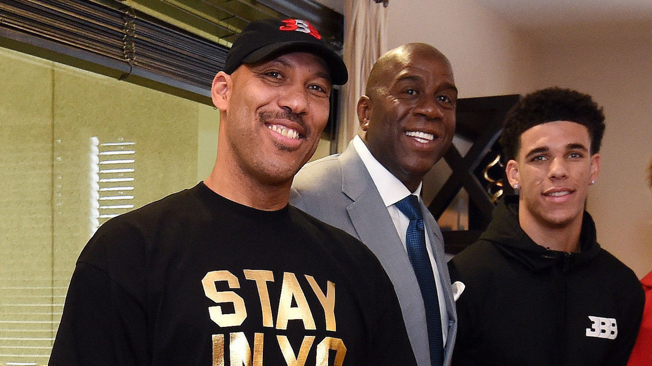 EL SEGUEDO, CA- JUNE 23: Lonzo Ball #2 of the Los Angeles Lakers poses for a picture with President of Basketball Operation of the Los Angeles Lakers, Magic Johnson, General Manager of the Los Angeles Lakers Rob Pelinka, his father LaVar Ball, his brothers LaMelo and LiAngelo Ball following a press conference to introduce Los Angeles Lakers 2017 NBA Draft picks in El Segundo, California. Mandatory Copyright Notice: Copyright 2016 NBAE