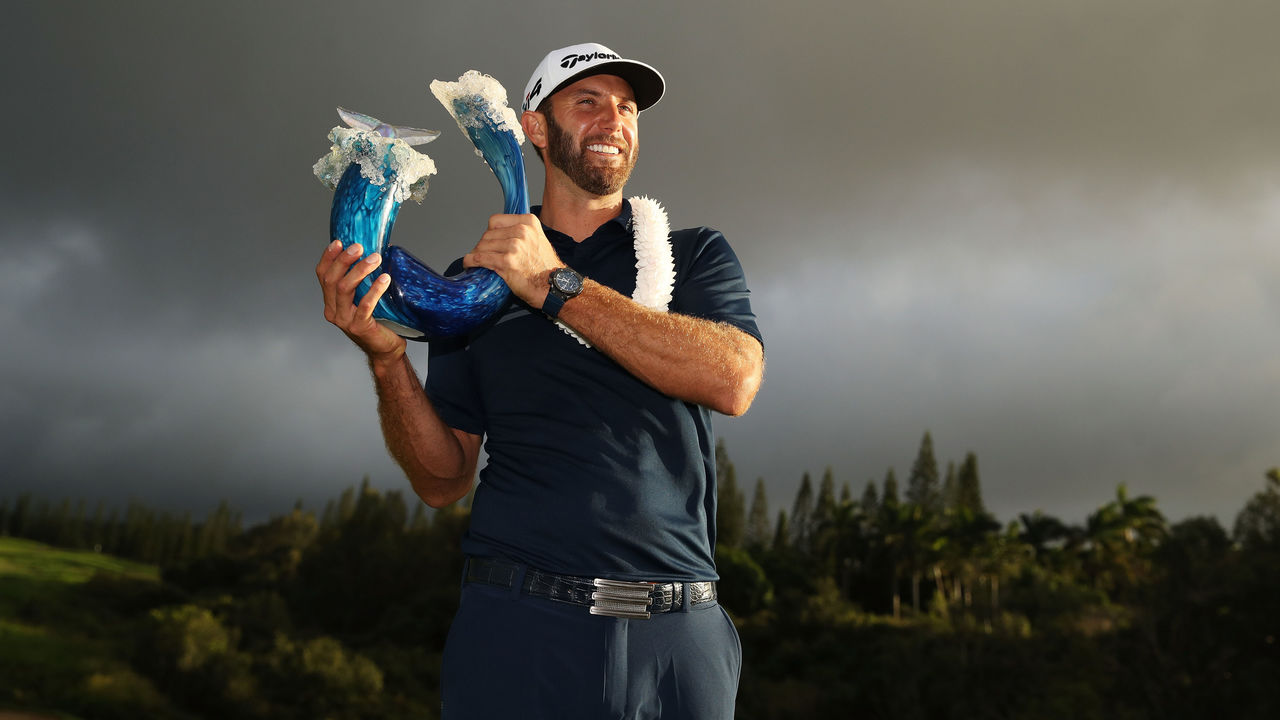 LAHAINA, HI - JANUARY 07: Dustin Johnson of the United States celebrates with the winner's trophy after the final round of the Sentry Tournament of Champions at Plantation Course at Kapalua Golf Club on January 7, 2018 in Lahaina, Hawaii.