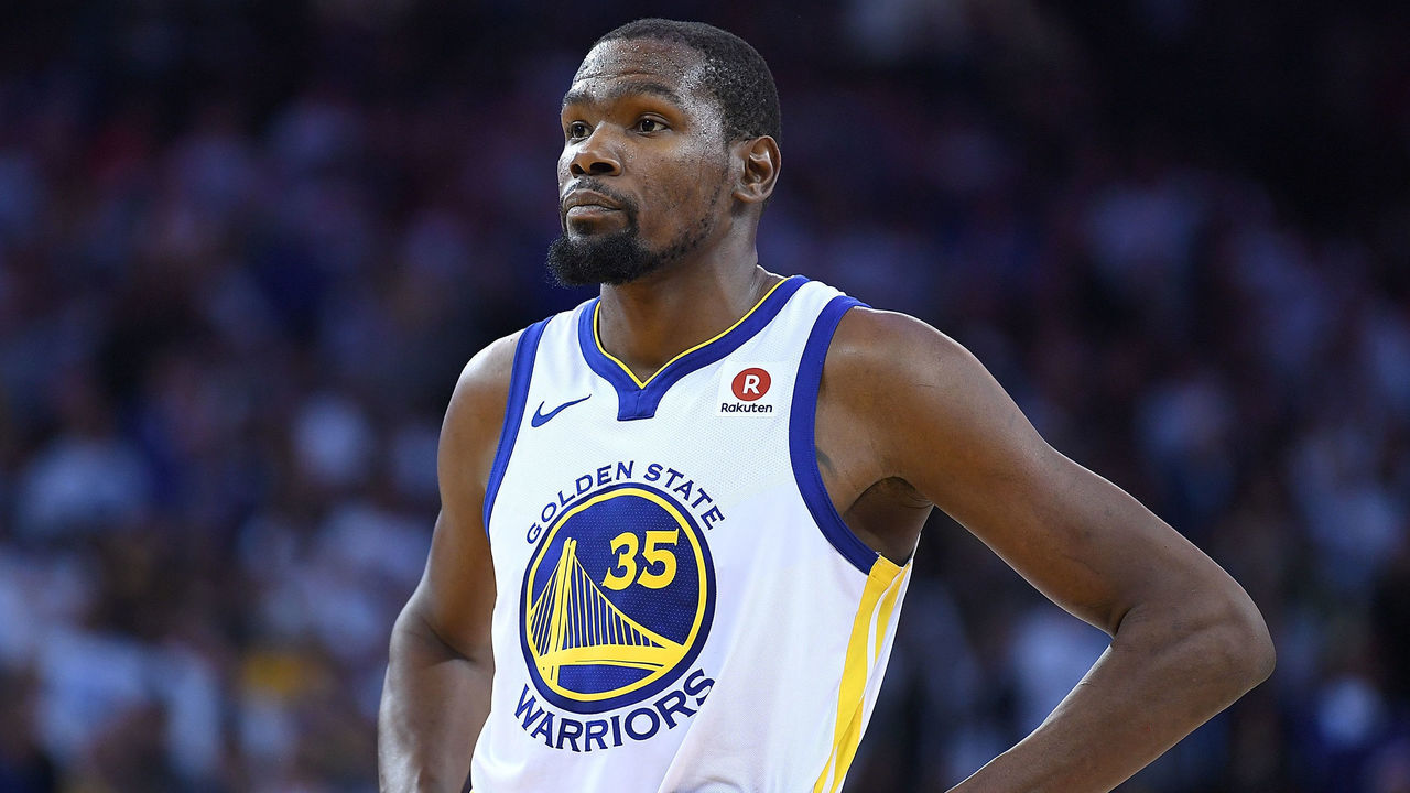OAKLAND, CA - DECEMBER 25: Kevin Durant #35 of the Golden State Warriors looks on while there's a break in the action against the Cleveland Cavaliers late in the fouth quarter of an NBA basketball game at ORACLE Arena on December 25, 2017 in Oakland, California.