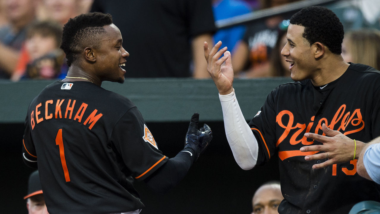 BALTIMORE, MD - AUGUST 04: Tim Beckham #1 of the Baltimore Orioles celebrates with his teammate Manny Machado #13 after hitting a solo home run in the second inning during a game against the Detroit Tigers at Oriole Park at Camden Yards on August 4, 2017 in Baltimore, Maryland.
