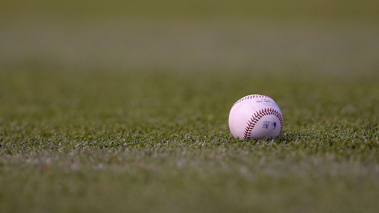 DENVER, CO - JUNE 11: The ball lies on the grass as the Atlanta Braves face the Colorado Rockies at Coors Field on June 11, 2014 in Denver, Colorado.