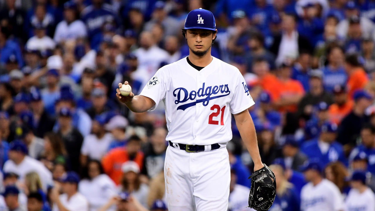 LOS ANGELES, CA - NOVEMBER 01: Yu Darvish #21 of the Los Angeles Dodgers reacts in the first inning against the Houston Astros in game seven of the 2017 World Series at Dodger Stadium on November 1, 2017 in Los Angeles, California.