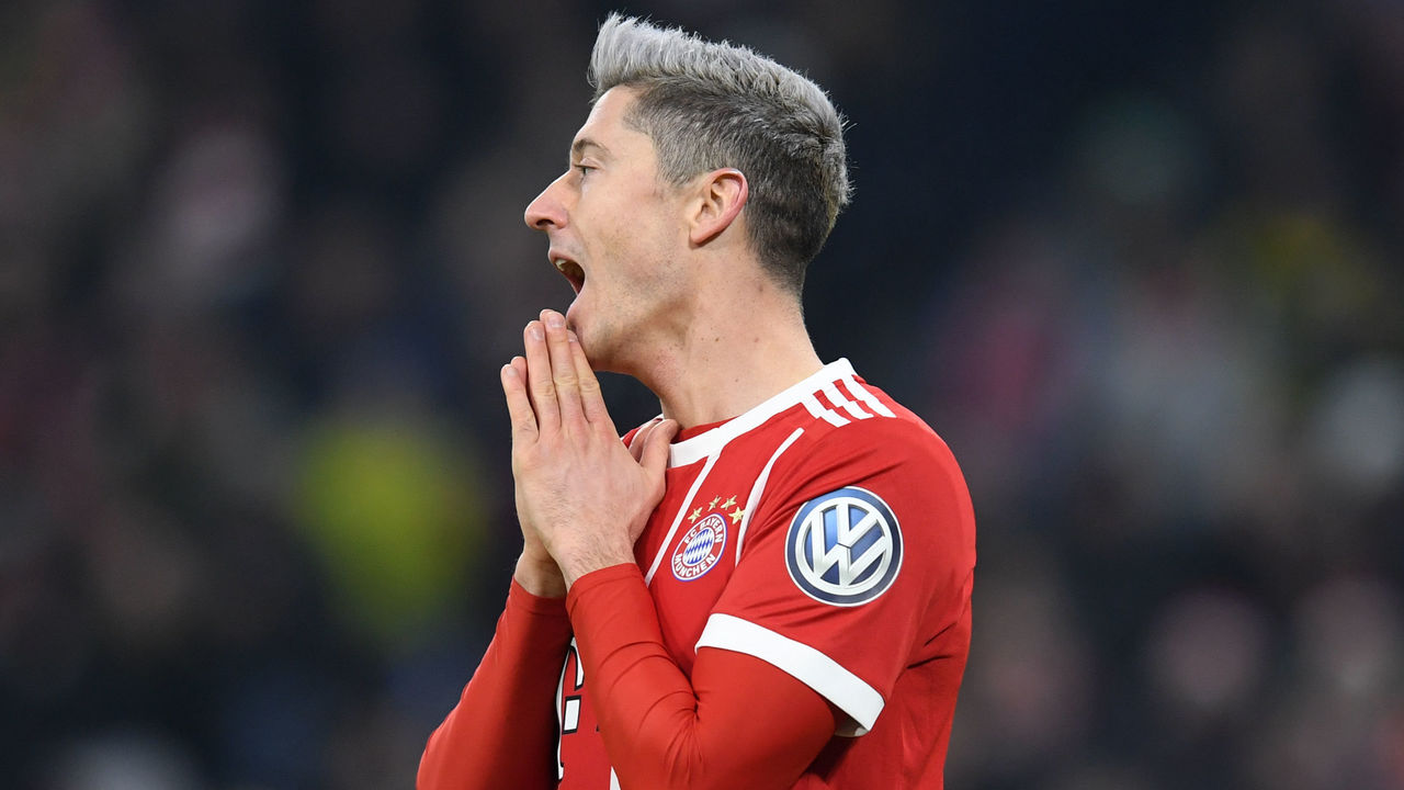 Bayern Munich's Polish striker Robert Lewandowski reacts during the German football Cup DFB Pokal round of sixteen match Bayern Munich vs Borussia Dortmund in Munich, southern Germany, on December 20, 2017. / AFP PHOTO / CHRISTOF STACHE