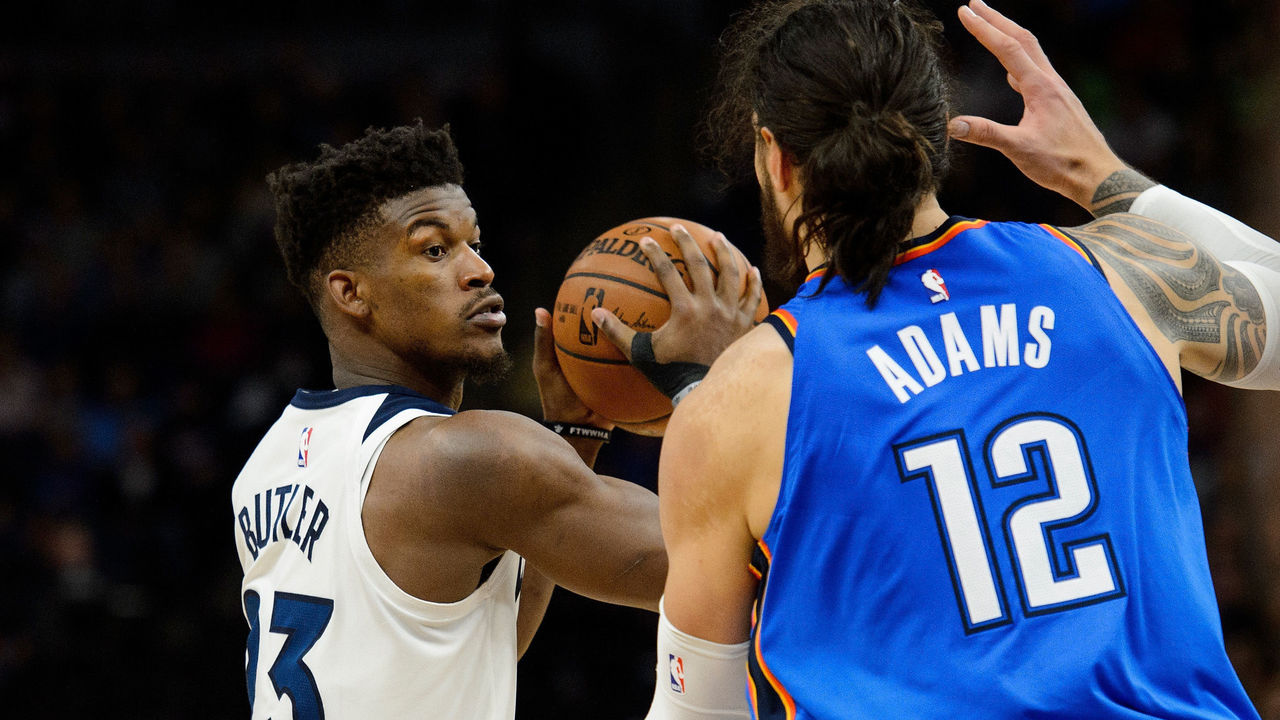 MINNEAPOLIS, MN - JANUARY 10: Jimmy Butler #23 of the Minnesota Timberwolves has the ball against Steven Adams #12 of the Oklahoma City Thunder during the game on January 10, 2018 at the Target Center in Minneapolis, Minnesota.