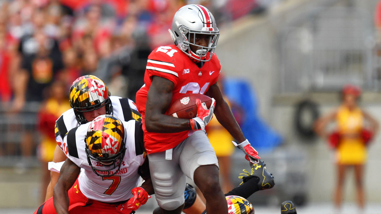 COLUMBUS, OH - OCTOBER 7: Parris Campbell #21 of the Ohio State Buckeyes breaks free from JC Jackson #7 of the Maryland Terrapins in the first quarter to pick up yardage at Ohio Stadium on October 7, 2017 in Columbus, Ohio.