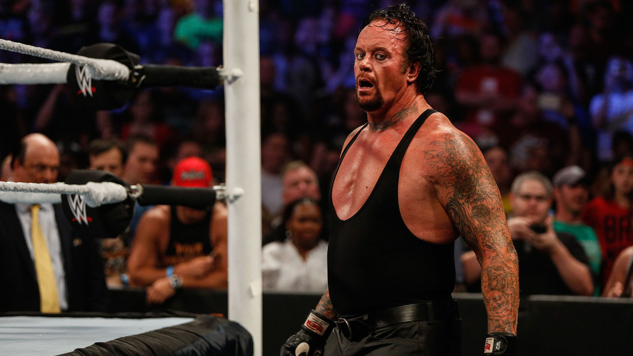 NEW YORK, NY - AUGUST 23: The Undertaker recovers during his fight against Brock Lesner at the WWE SummerSlam 2015 at Barclays Center of Brooklyn on August 23, 2015 in New York City.