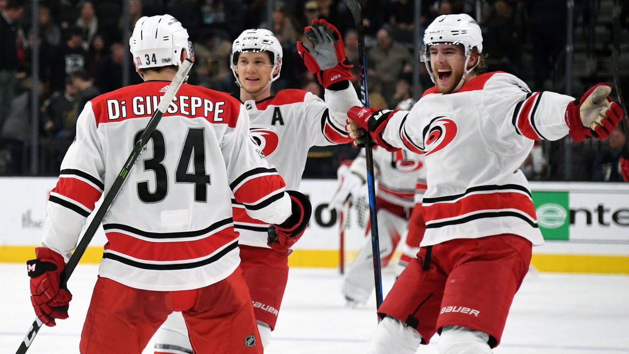 LAS VEGAS, NV - DECEMBER 12: (L-R) Phillip Di Giuseppe #34 of the Carolina Hurricanes celebrates with teammates Jeff Skinner #53 and Noah Hanifin #5 after Di Giuseppe scored against the Vegas Golden Knights in a shootout to win the game 3-2 at T-Mobile Arena on December 12, 2017 in Las Vegas, Nevada.