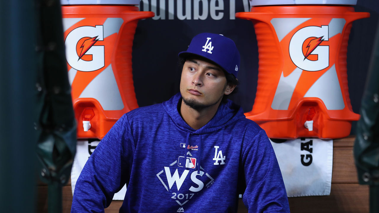 HOUSTON, TX - OCTOBER 28: Yu Darvish #21 of the Los Angeles Dodgers looks on during warm ups before game four of the 2017 World Series against the Houston Astros at Minute Maid Park on October 28, 2017 in Houston, Texas.