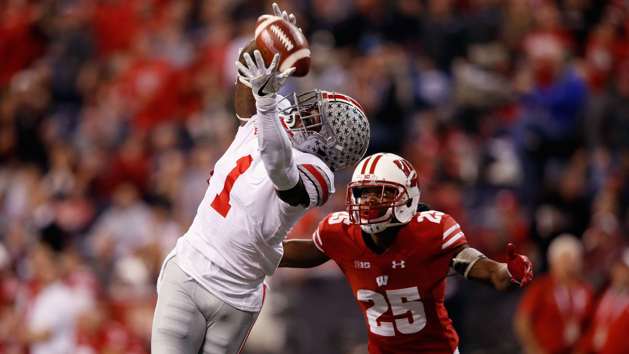 INDIANAPOLIS, IN - DECEMBER 02: Wide receiver Johnnie Dixon #1 of the Ohio State Buckeyes reaches for an incomplete pass against safety Scott Nelson #25 of the Wisconsin Badgers in the second half during the Big Ten Championship game at Lucas Oil Stadium on December 2, 2017 in Indianapolis, Indiana.