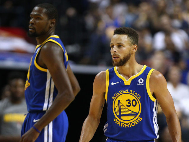 SHANGHAI, CHINA - OCTOBER 08: Stephen Curry #30 and Kevin Durant #35 of the Golden State Warriors look on during the game between the Minnesota Timberwolves and the Golden State Warriors as part of 2017 NBA Global Games China at Mercedes-Benz Arena on October 8, 2017 in Shanghai, China.