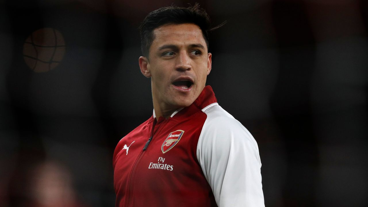 Arsenal's Chilean striker Alexis Sanchez warms up before the English Premier League football match between Arsenal and Chelsea at the Emirates Stadium in London on January 3, 2018. / AFP PHOTO / Adrian DENNIS /