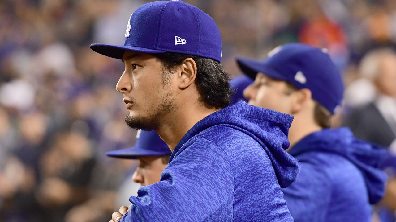 LOS ANGELES, CA - OCTOBER 31: Yu Darvish #21 of the Los Angeles Dodgers looks on from the dugout in game six of the 2017 World Series against the Houston Astros at Dodger Stadium on October 31, 2017 in Los Angeles, California.
