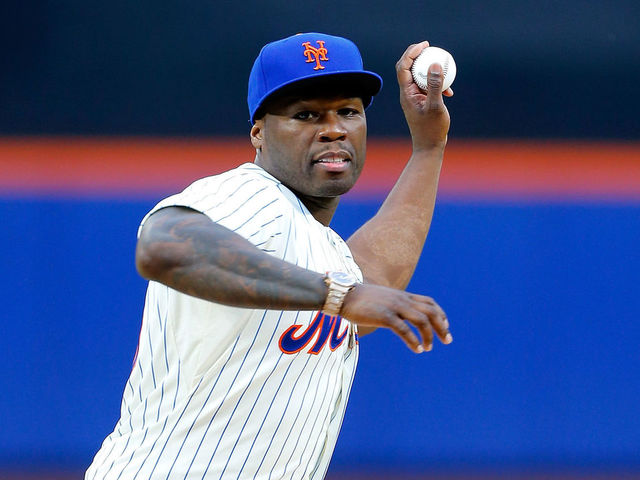 NEW YORK, NY - MAY 27: Rap artist 50 Cent throws the ceremonial first pitch of a game between the New York Mets and the Pittsburgh Pirates at Citi Field on May 27, 2014 in the Flushing neighborhood of the Queens borough of New York City.
