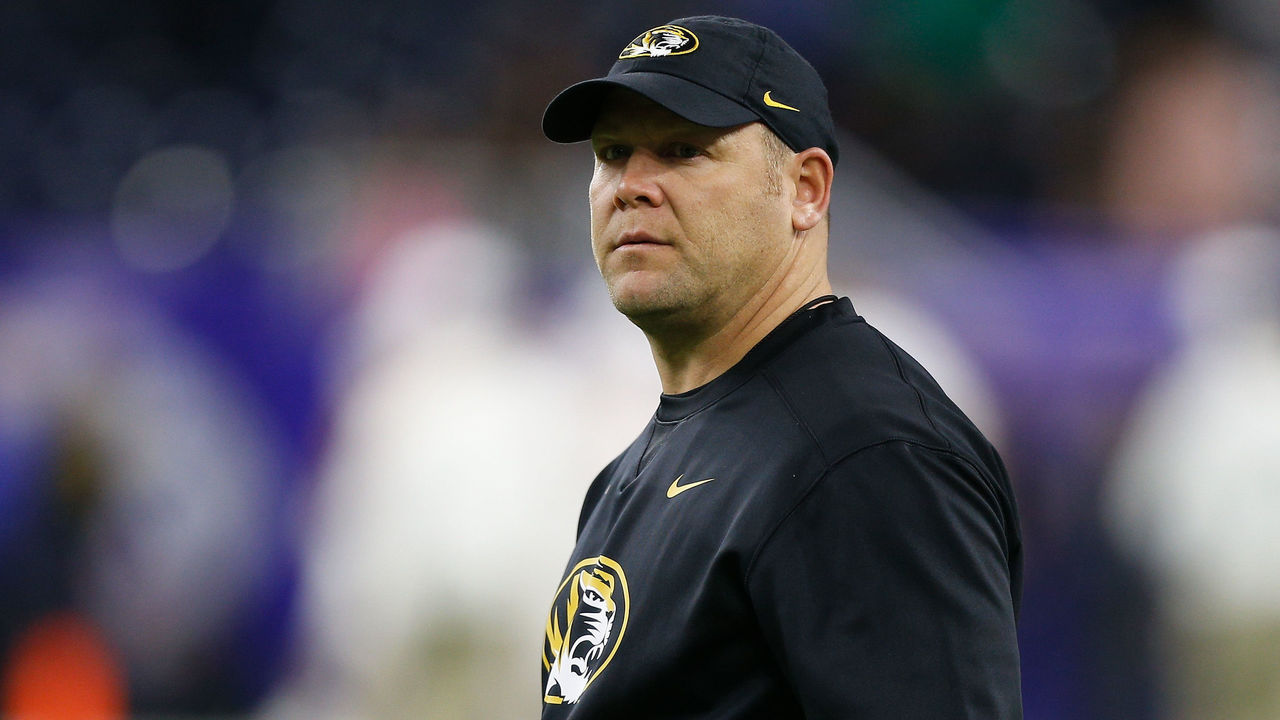 HOUSTON, TX - DECEMBER 27: Head coach Barry Odom of the Missouri Tigers takes the field during warm ups before playing the Texas Longhorns in the Academy Sports & Outdoors Bowl at NRG Stadium on December 27, 2017 in Houston, Texas.