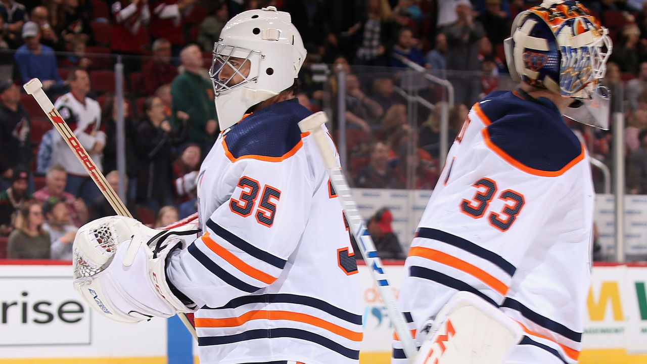 GLENDALE, AZ - JANUARY 12: Goaltender Al Montoya #35 of the Edmonton Oilers replaces Cam Talbot #33 during the first period of the NHL game against the Arizona Coyotes at Gila River Arena on January 12, 2018 in Glendale, Arizona.