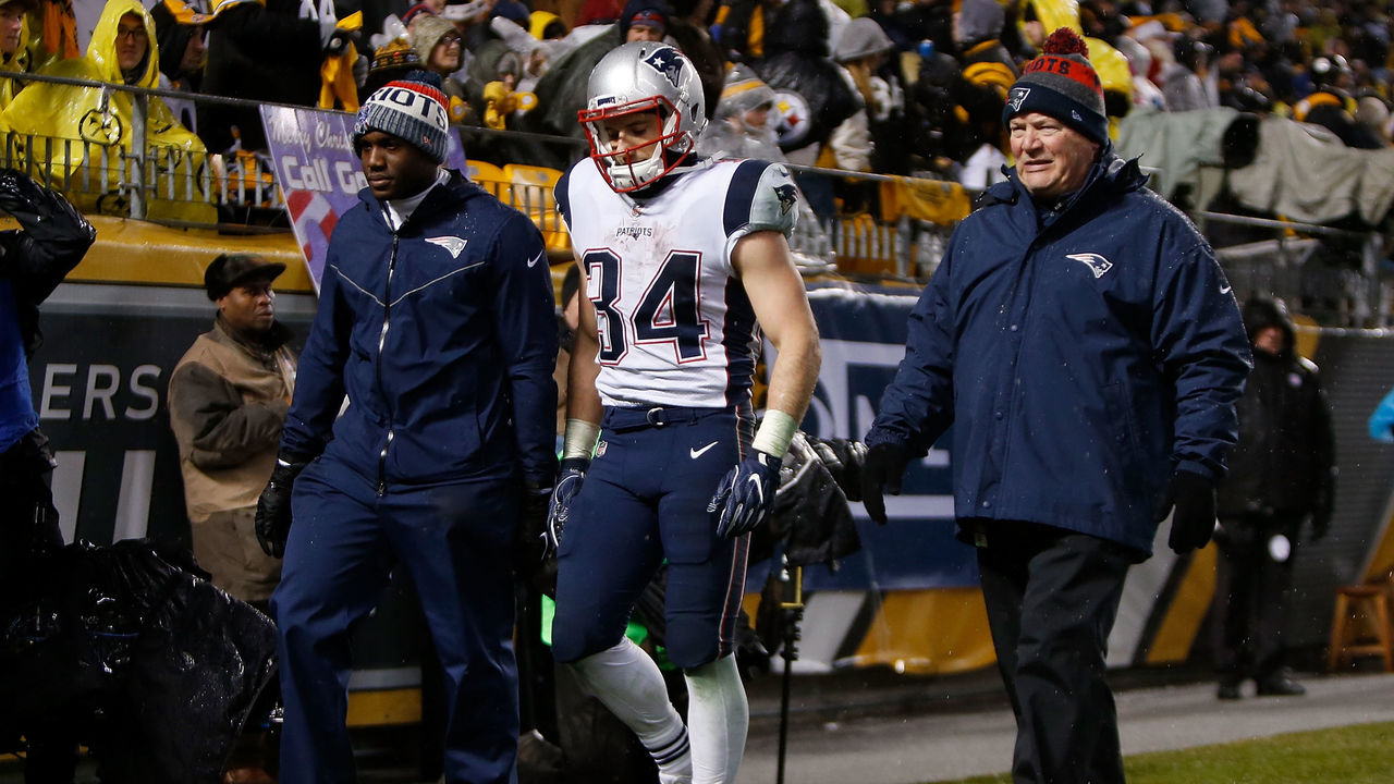 PITTSBURGH, PA - DECEMBER 17: Rex Burkhead #34 of the New England Patriots walks off the field with trainers in the third quarter during the game against the Pittsburgh Steelers at Heinz Field on December 17, 2017 in Pittsburgh, Pennsylvania.
