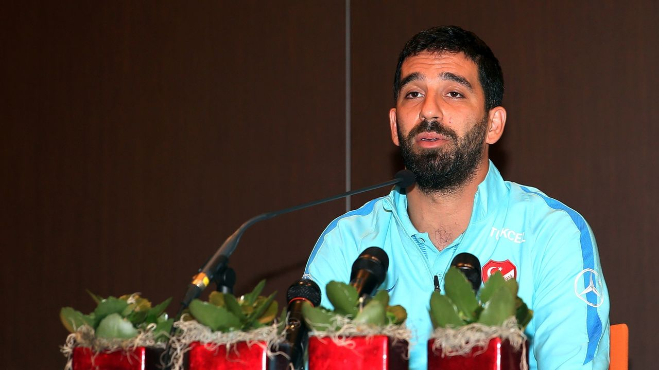 Barcelona's Turkish midfielder and Turkey's captain Arda Turan addresses a press conference announcing his retirement from international football in Portoroz, Slovenia, on June 6, 2017. Turan announced his retirement from international football on Tuesday, hours after being kicked out of a training camp by coach Fatih Terim for allegedly verbally and physically abusing a journalist. Turan had been told to leave the Turkey team's camp in Slovenia where they are preparing for a 2018 World Cup qualifier against Kosovo on June 11, the daily Hürriyet and news channel NTV earlier reported. / AFP PHOTO / STR