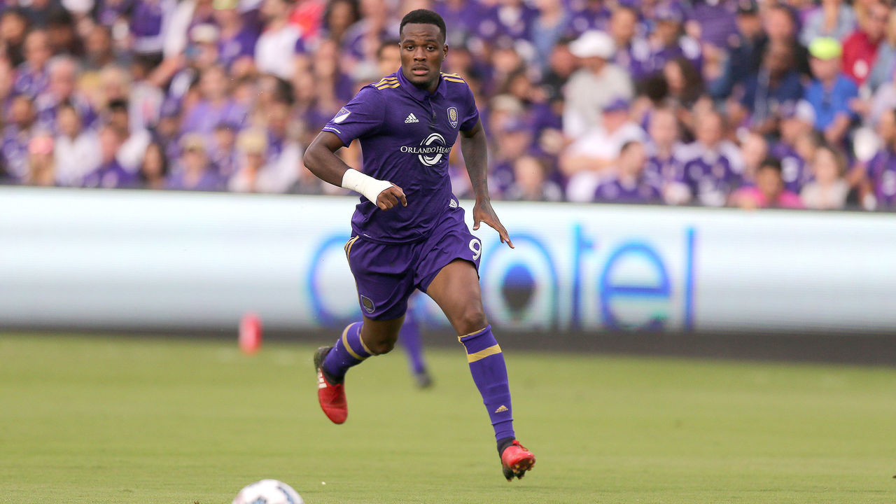 ORLANDO, FL - MARCH 05: Cyle Larin #9 of Orlando City SC chases the ball during a MLS soccer match between New York City FC and Orlando City SC at the Orlando City Stadium on March 5, 2017 in Orlando, Florida.