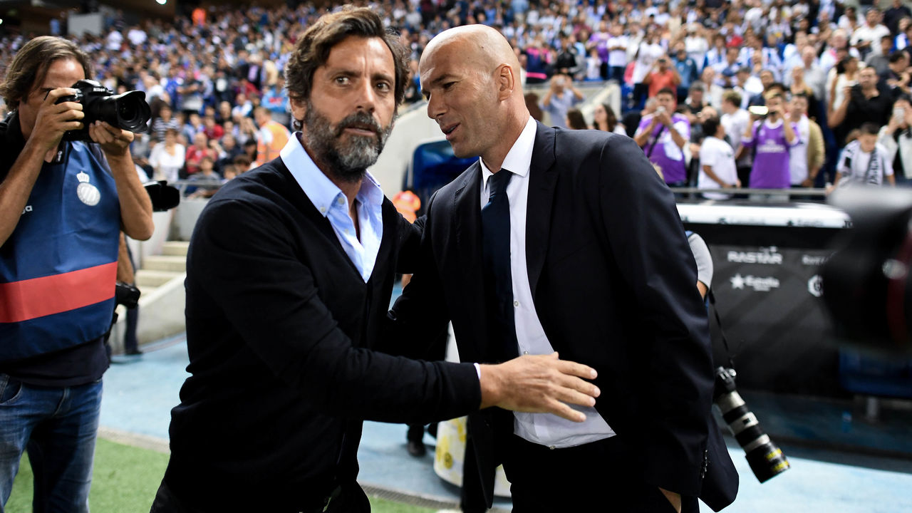 BARCELONA, SPAIN - SEPTEMBER 18: Head coach Quique Sanchez Flores (L) of RCD Espanyol and Head coach Zinedine Zidane of Real Madrid CF shake hands prior to the La Liga match between RCD Espanyol and Real Madrid CF at the RCDE stadium on September 18, 2016 in Barcelona, Spain.