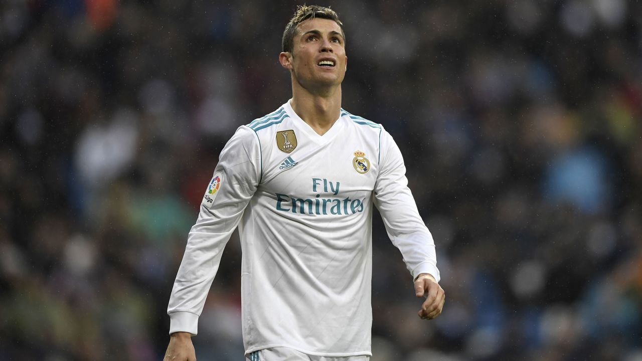 Real Madrid's Portuguese forward Cristiano Ronaldo reacts after missing a goal opportunity during the Spanish league football match between Real Madrid and Villarreal at the Santiago Bernabeu Stadium in Madrid on January 13, 2018. / AFP PHOTO / GABRIEL BOUYS