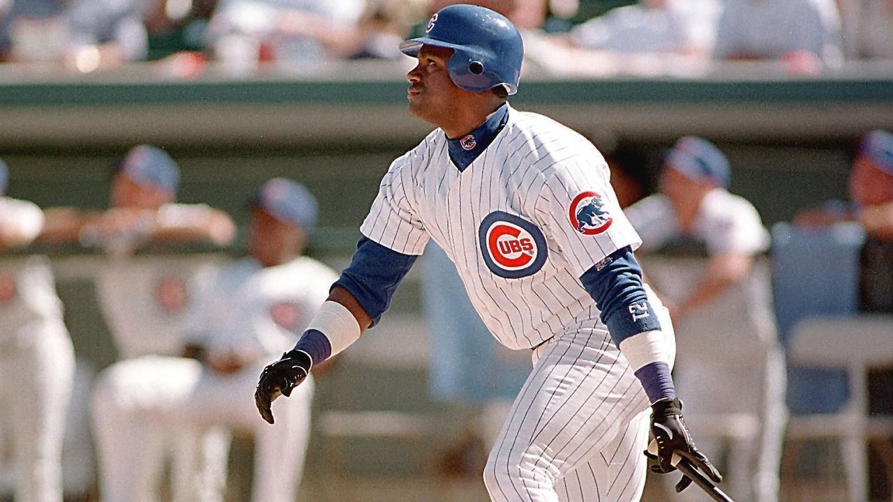 MESA, : Chicago Cubs slugger Sammy Sosa watches his ball go deep into center field for an out against the Seattle Mariners during Cactus League play 05 March in Mesa, Arizona. Sosa hit 66 home runs in the 1998 baseball season behind St. Louis Cardinal Mark McGwire, who hit 70. AFP PHOTO/John G. MABANGLO