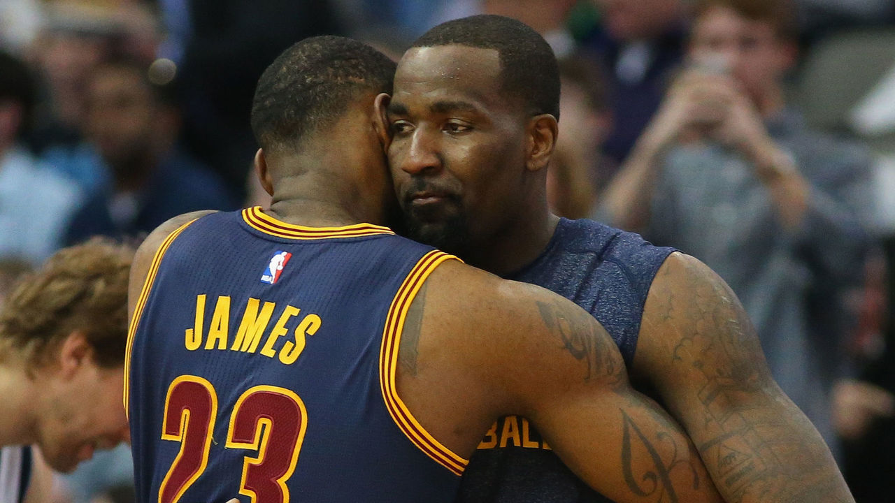 DALLAS, TX - MARCH 10: (L-R) LeBron James #23 and Kendrick Perkins #3 of the Cleveland Cavaliers hug before a game against the Dallas Mavericks at American Airlines Center on March 10, 2015 in Dallas, Texas.
