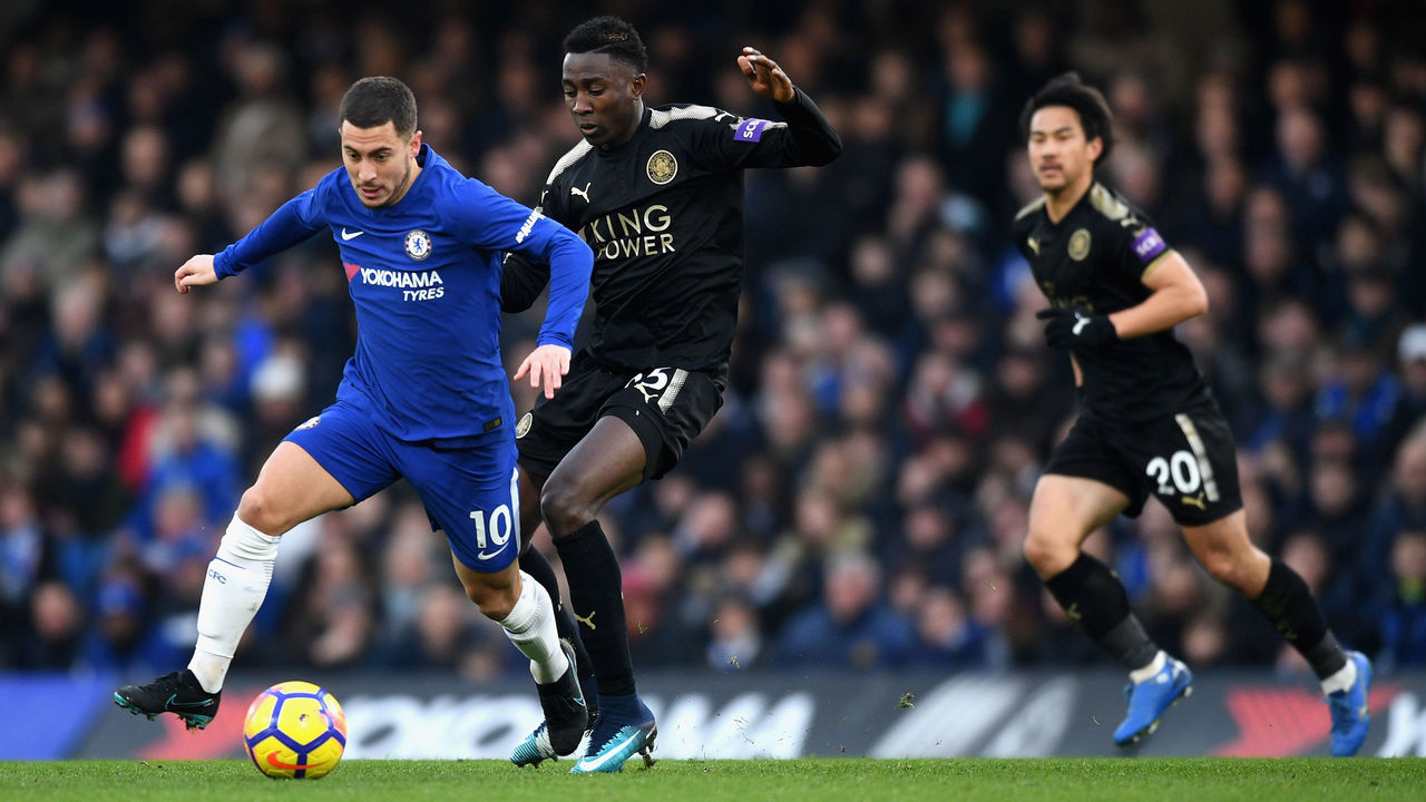 LONDON, ENGLAND - JANUARY 13: Eden Hazard of Chelsea is challenged by Wilfred Ndidi of Leicester City during the Premier League match between Chelsea and Leicester City at Stamford Bridge on January 13, 2018 in London, England.