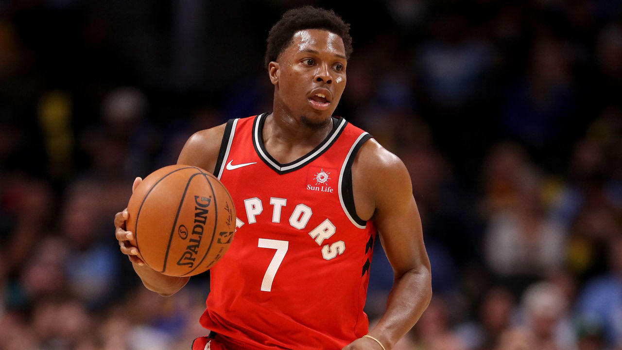 DENVER, CO - NOVEMBER 01: Kyle Lowry #7 of the Toronto Raptors brings the ball down the court against the Denver Nuggets at the Pepsi Center on November 1, 2017 in Denver, Colorado.