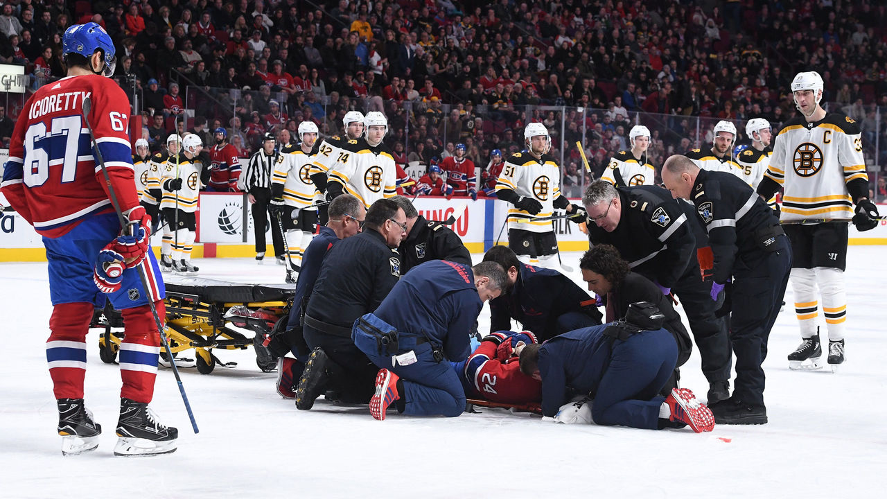 MONTREAL, QC - JANUARY 13: Phillip Danault #24 of the Montreal Canadiens is assisted off the ice after an injury In the second period of NHL game against the Boston Bruins at the Bell Centre on January 13, 2018 in Montreal, Quebec, Canada.