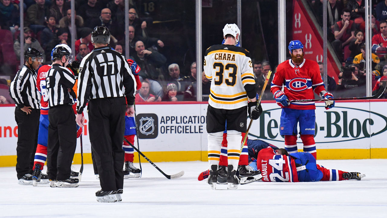 MONTREAL, QC - JANUARY 13: Montreal Canadiens Center Phillip Danault (24) lays on the ice for long minutes after being hit on the head by a shot from Boston Bruins Defenceman Zdeno Chara (33) during the Boston Bruins versus the Montreal Canadiens game on January 13, 2018, at Bell Centre in Montreal, QC