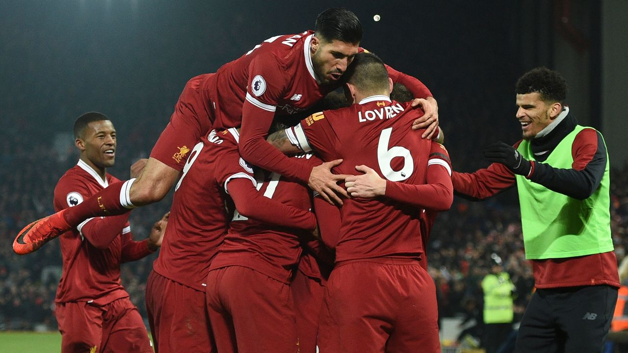 Liverpool's German midfielder Emre Can (L) jumps into the celebration for the third Liverpool goal scored by Liverpool's Senegalese midfielder Sadio Mane during the English Premier League football match between Liverpool and Manchester City at Anfield in Liverpool, north west England on January 14, 2018. / AFP PHOTO / Oli SCARFF /