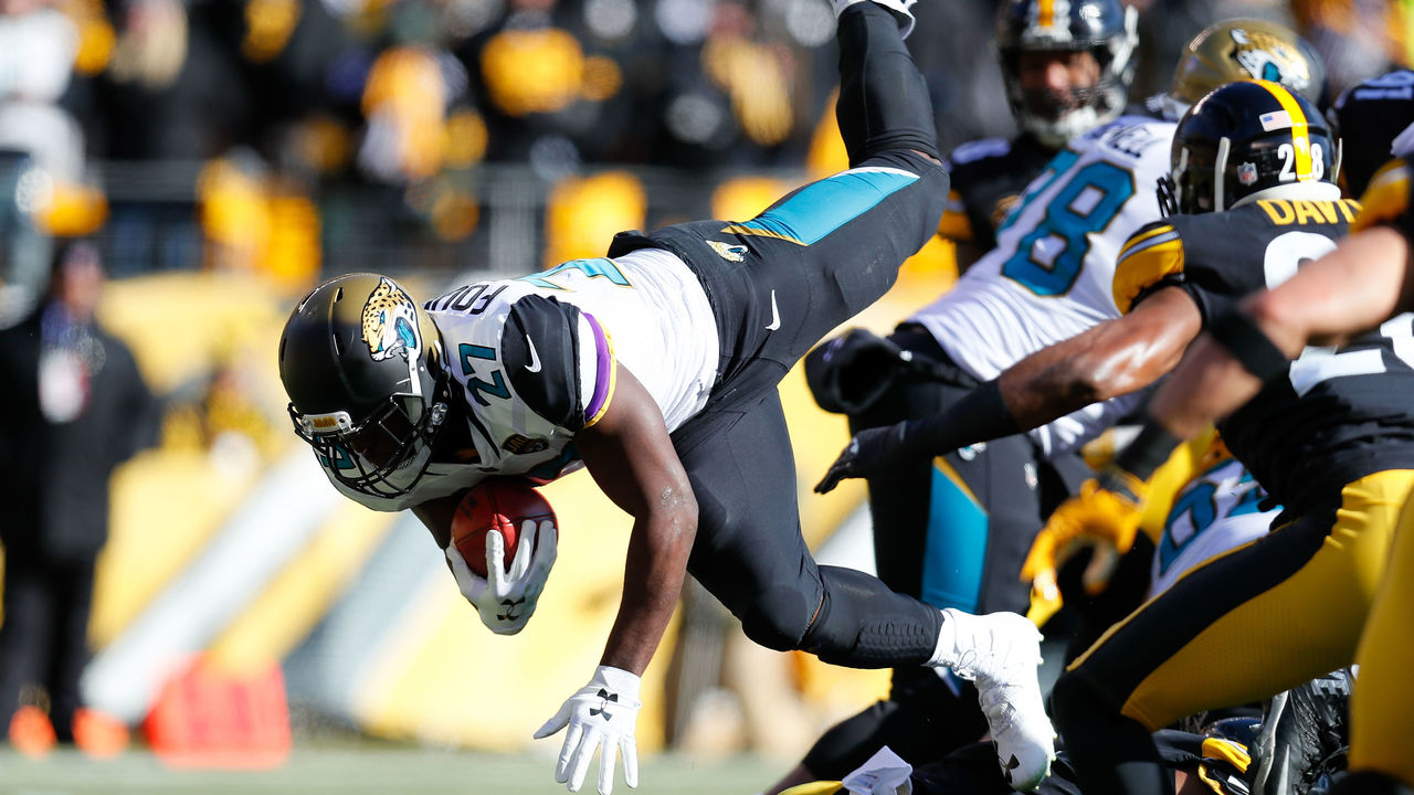 PITTSBURGH, PA - JANUARY 14: Leonard Fournette #27 of the Jacksonville Jaguars dives into the end zone for a touchdown against the Pittsburgh Steelers during the first half of the AFC Divisional Playoff game at Heinz Field on January 14, 2018 in Pittsburgh, Pennsylvania.