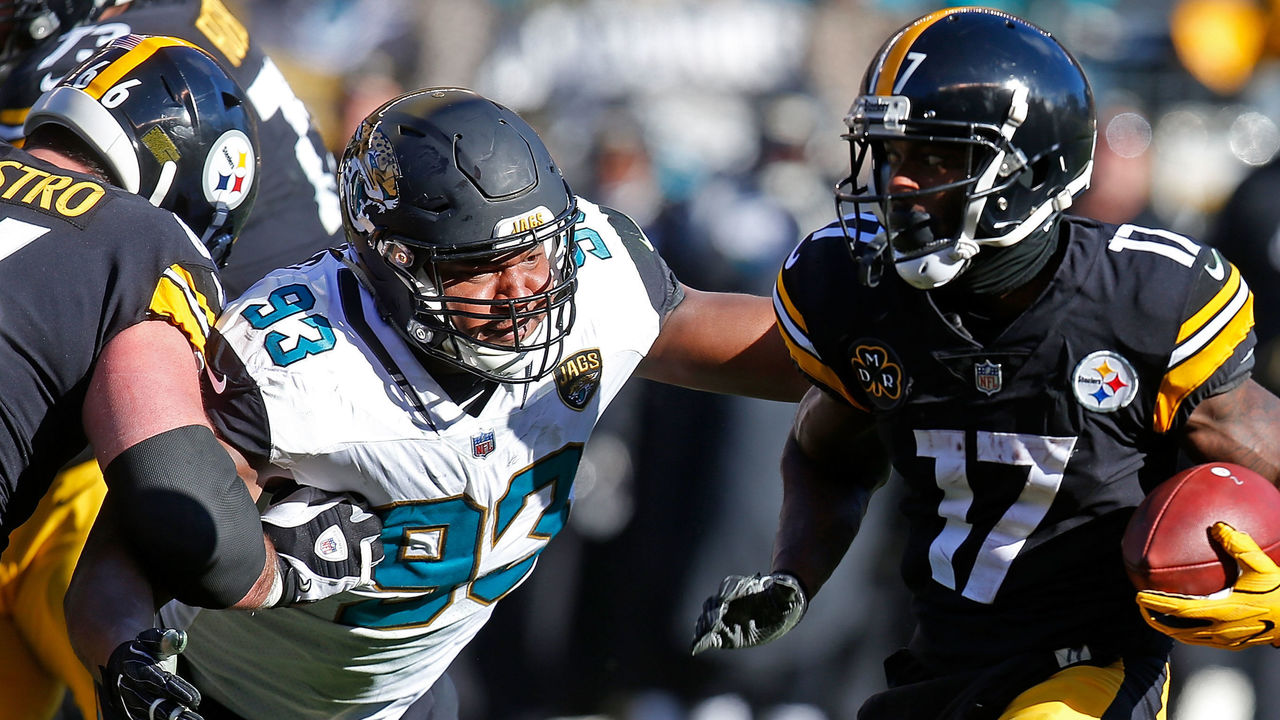 PITTSBURGH, PA - JANUARY 14: Eli Rogers #17 of the Pittsburgh Steelers runs up field against Calais Campbell #93 of the Jacksonville Jaguars after a reception in the first half during the AFC Divisional Playoff game at Heinz Field on January 14, 2018 in Pittsburgh, Pennsylvania.
