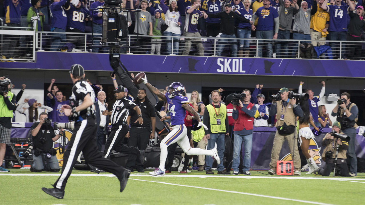 MINNEAPOLIS, MN - JANUARY 14: Stefon Diggs #14 of the Minnesota Vikings runs with the ball to score a touchdown and with as time expired in the NFC Divisional Playoff game against the New Orleans Saints on January 14, 2018 at U.S. Bank Stadium in Minneapolis, Minnesota.