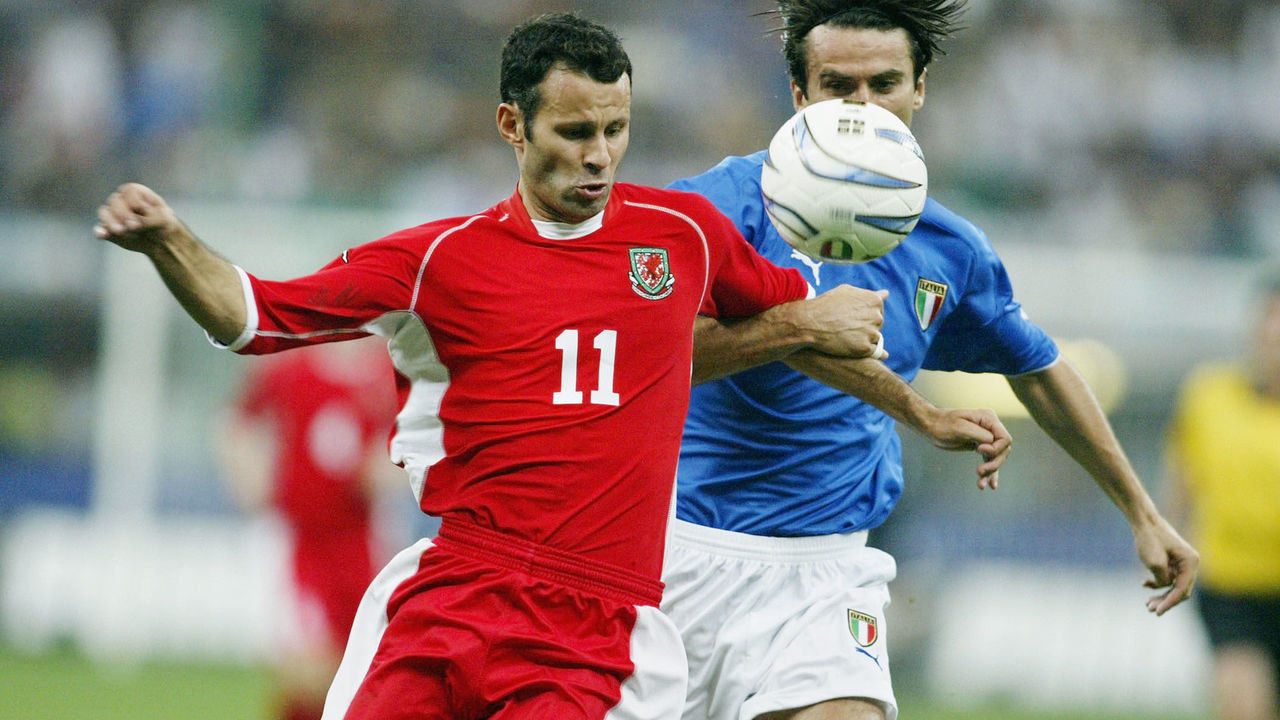 MILAN, ITALY - SEPTEMBER 6: Ryan Giggs of Wales battles with Christian Panucci of Italy during the Euro 2004 Qualifier Group 9 match between Italy and Wales at the San Siro on September 6, 2003 in Milan, Italy.