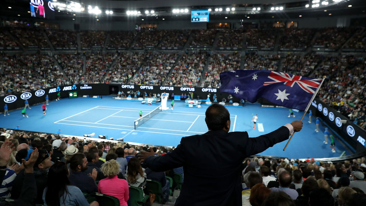 MELBOURNE, AUSTRALIA - JANUARY 26: A spectator waves the Australian flag on Australia Day during the semifinal match between Stan Wawrinka of Switzerland and Roger Federer of Switzerland on day 11 of the 2017 Australian Open at Melbourne Park on January 26, 2017 in Melbourne, Australia.