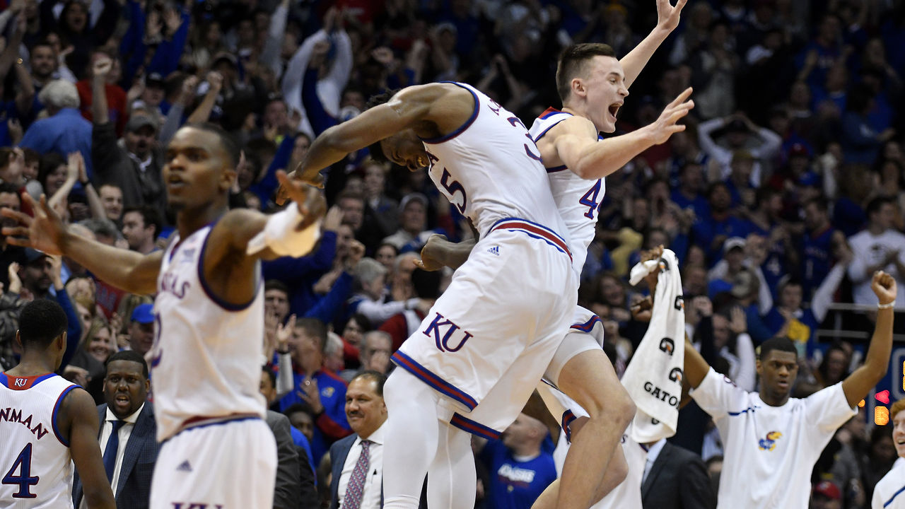 LAWRENCE, KS - JANUARY 13: Udoka Azubuike #35 and Mitch Lightfoot #44 of the Kansas Jayhawks celebrate a 73-72 win over the Kansas State Wildcats at Allen Fieldhouse on January 13, 2018 in Lawrence, Kansas.