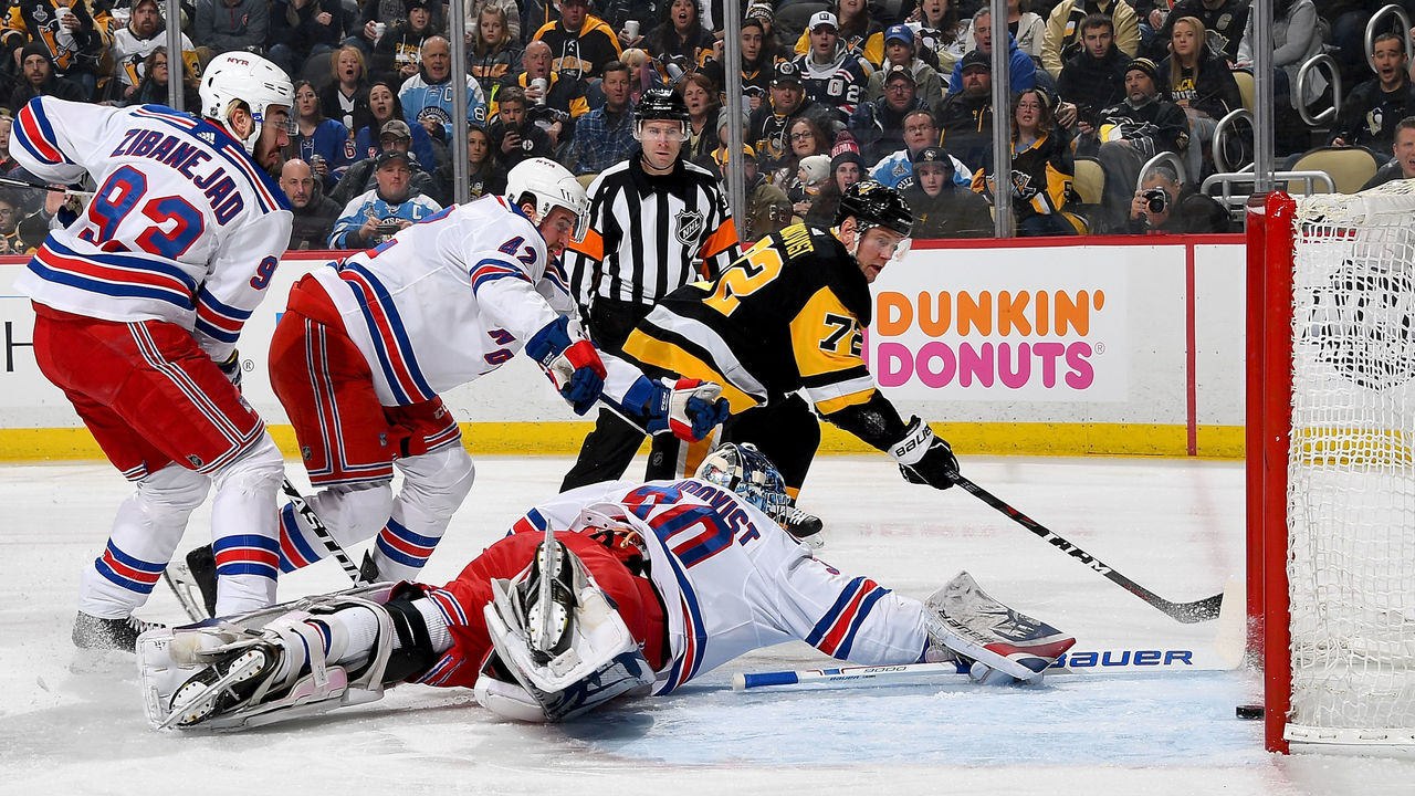 PITTSBURGH, PA - JANUARY 14: Patric Hornqvist #72 of the Pittsburgh Penguins scores past Henrik Lundqvist #30 of the New York Rangers in the first period at PPG Paints Arena on January 14, 2018 in Pittsburgh, Pennsylvania.