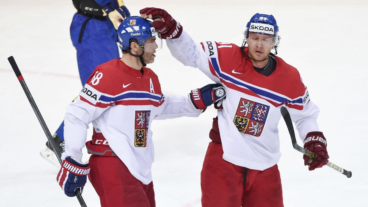 Czech Republic's forward Jaromir Jagr (L) celebrates with his teammate forward Martin Erat after scoring a goal during the group A preliminary round ice hockey match Czech Republic vs Sweden of the IIHF International Ice Hockey World Championship on May 1, 2015 at the O2 Arena in Prague. AFP PHOTO / JONATHAN NACKSTRAND