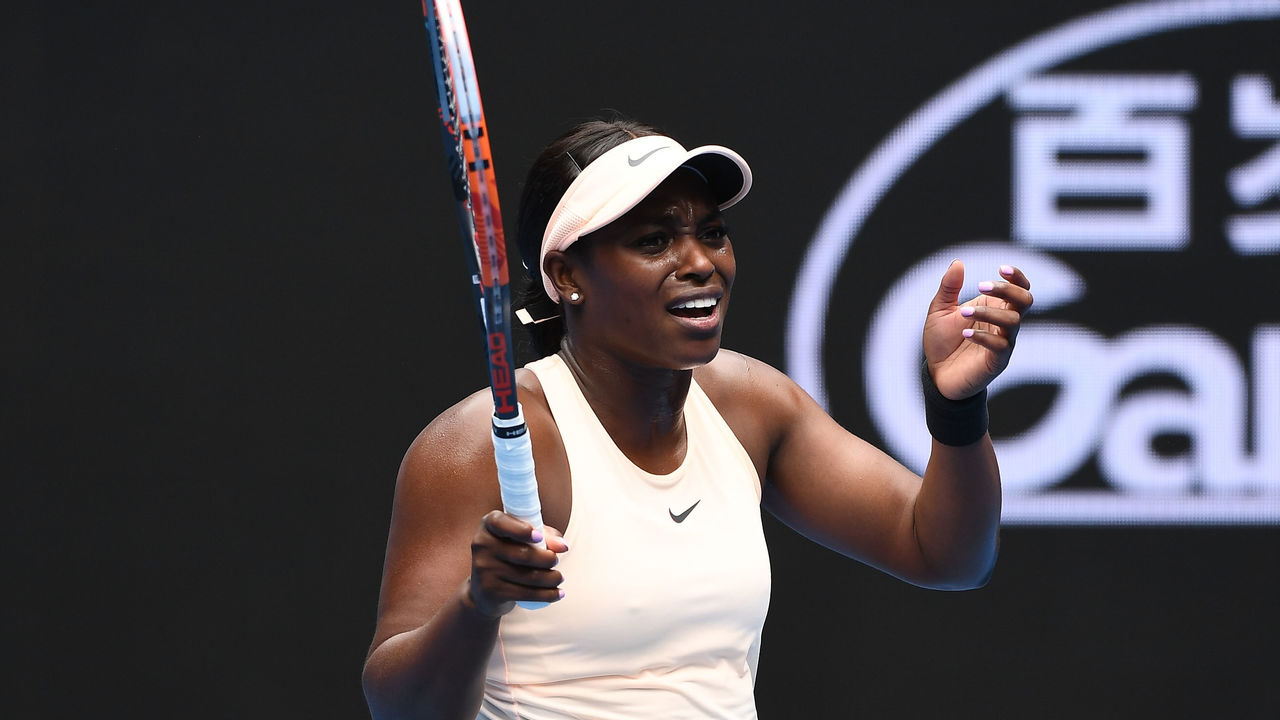 MELBOURNE, AUSTRALIA - JANUARY 15: Sloane Stephens of the United States reacts in her first round match against Shuai Zhang of China on day one of the 2018 Australian Open at Melbourne Park on January 15, 2018 in Melbourne, Australia.